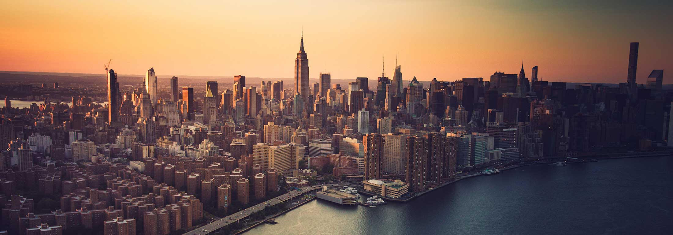 Aerial view of Manhattan with crisp orange sunrise